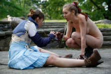 """Kara Lynn, left, as Ferdinand, and Marisa Roper, as Miranda perform at Summit Rock in Central Park during the Outdoor Co-Ed Topless Pulp Fiction theater company's production of Shakespeare's """"The Tempest,"""" Thursday, May 19, 2016, in New York. An all-female cast of 13 actors, dancers, and musicians perform in this a """"stripped-down"""" production which has been for shorter running time. The production uses semi- and full-nudity to celebrate body freedom and free expression and to dramatize the conflict between the visitors to Prospero's island and its inhabitants. (AP Photo/Kathy Willens)"""
